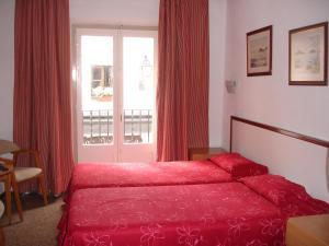 Llit o llits en una habitació de Maria Rosa