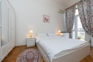 Lova arba lovos apgyvendinimo įstaigoje Alma Apartments