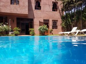 The swimming pool at or near Targa Suite
