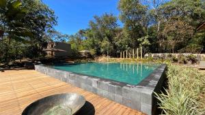 The swimming pool at or near Capim do Mato Pousada & Spa by L'Occitane