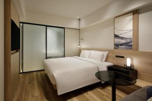 A bed or beds in a room at Fairfield by Marriott Osaka Namba