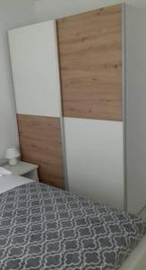 A bed or beds in a room at Apartmani Ponistra