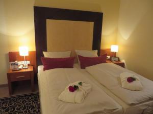 Ein Bett oder Betten in einem Zimmer der Unterkunft Ringhotel Bundschu