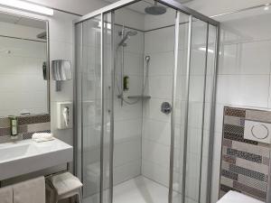Ein Badezimmer in der Unterkunft Hotel Wieting