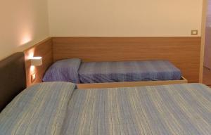 Letto o letti in una camera di Residenza Campicioi