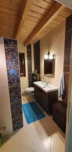 A bathroom at Wooden House&Pool