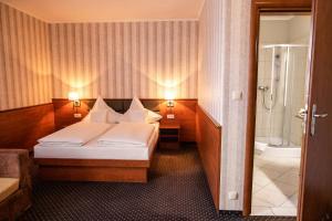 Łóżko lub łóżka w pokoju w obiekcie Premium Hotel Bacero Wrocław