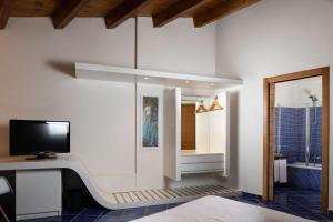 A television and/or entertainment center at Magaggiari Hotel Resort