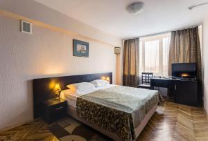 Кровать или кровати в номере Гостиница Университетская