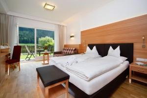 Кровать или кровати в номере Hotel Grones