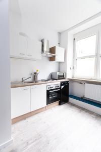 Küche/Küchenzeile in der Unterkunft Huxx Süd