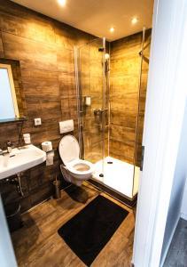 Ein Badezimmer in der Unterkunft Huxx Süd