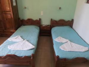 A bed or beds in a room at Salvanos Residence