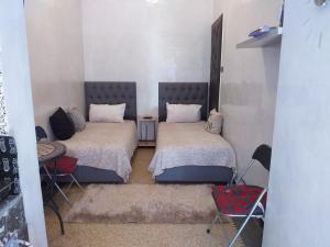 A bed or beds in a room at studio Dar Rmila