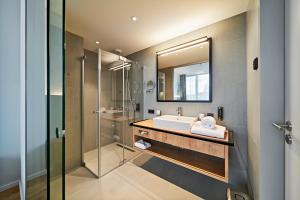 Ein Badezimmer in der Unterkunft Hotel Federwerk