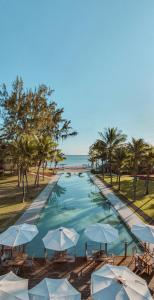 A view of the pool at Outrigger Mauritius Beach Resort or nearby