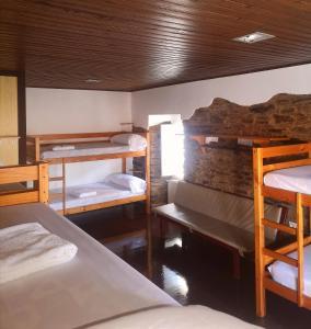A bunk bed or bunk beds in a room at Albergue O Botafumeiro