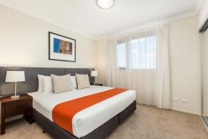 A bed or beds in a room at Quest Breakfast Creek
