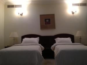 A bed or beds in a room at Sea Scene Hotel Apartments