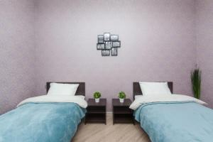 A bed or beds in a room at Spikado - Hotel Kutuzovskiy