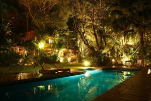 The swimming pool at or near Casa Natureza Brasil