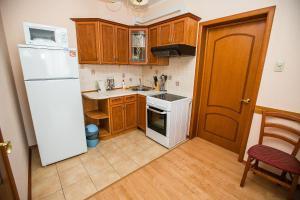 A kitchen or kitchenette at Diadema Apart Hotel