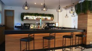 De lounge of bar bij Aparthotel Floramar