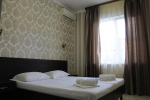 A bed or beds in a room at Ahilles Palace