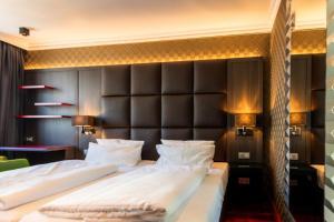 Ein Bett oder Betten in einem Zimmer der Unterkunft Hotel Haverkamp