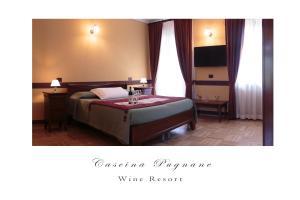 Letto o letti in una camera di Cascina Pugnane Wine Resort