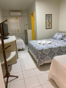 A bed or beds in a room at Pousada Kanamary