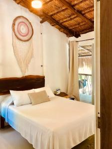 A bed or beds in a room at Playa Xcanan Tulum