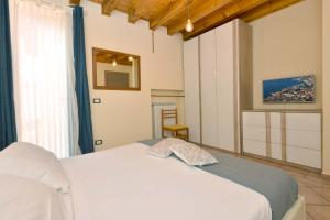 A bed or beds in a room at Antiche Rive Holidays Apartments