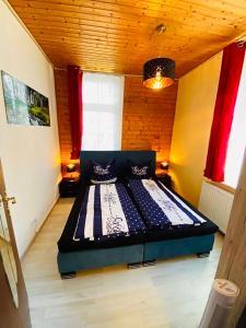 Ein Bett oder Betten in einem Zimmer der Unterkunft Ferienhaus Zur Abzuchtinsel