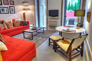 A seating area at Three Houses & Bedrooms