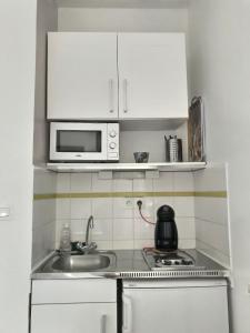 Cuisine ou kitchenette dans l'établissement Résidence Amiens hyper Centre