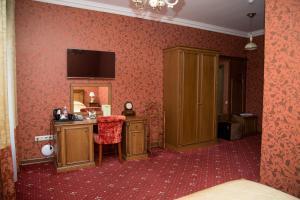 Телевизор и/или развлекательный центр в Гостиница Россия