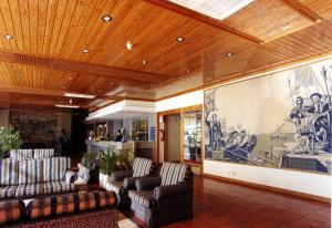 The lobby or reception area at Hotel Senhora do Castelo