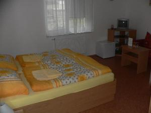 A bed or beds in a room at Vila Heda