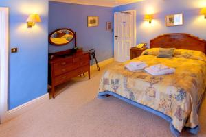 A bed or beds in a room at The Wynnstay