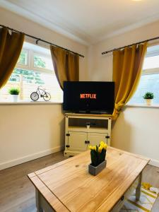 A television and/or entertainment center at Longfield Serviced Apartment