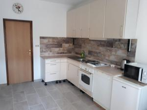 A kitchen or kitchenette at Apartments Jurlina