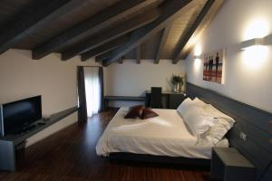 A bed or beds in a room at Albergo al Vecchio Tram