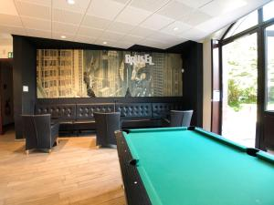 A pool table at Generation Europe Youth Hostel