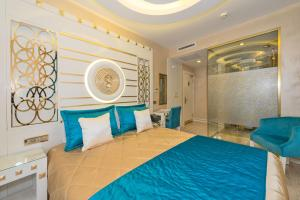 A bed or beds in a room at The Million Stone Hotel - Special Category