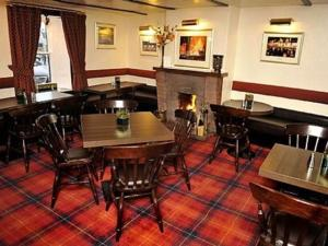 A restaurant or other place to eat at Elphinstone Hotel