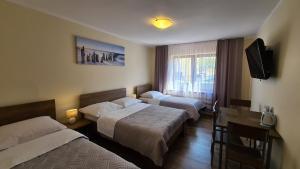 Łóżko lub łóżka w pokoju w obiekcie DW Bianca