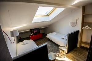 A bed or beds in a room at Les Catalons