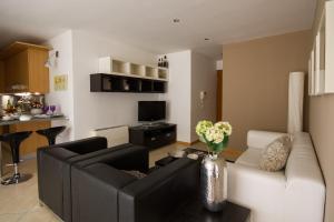 A seating area at Apartments Casa Emonia