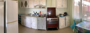 A kitchen or kitchenette at Гостевой Дом Евгения